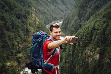 Male Hiker Taking Selfie While...