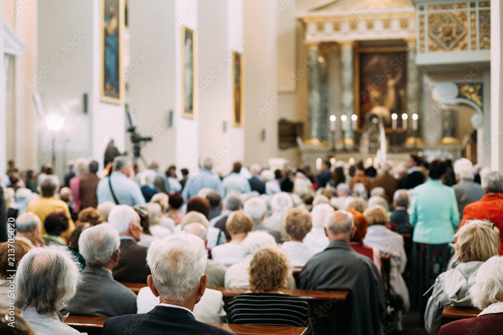 Fototapeta Group Of Old People Parishioners in Cathedral Church