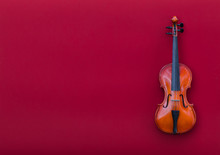 Violin On Red Isolated Backgro...