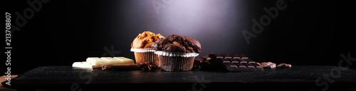 Chocolate muffin and nut muffin, homemade bakery on dark background Fototapeta