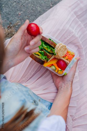 Foto op Aluminium Assortiment Close up of girl eating from lunch box