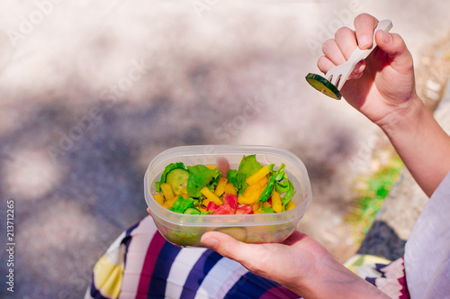 Foto op Aluminium Assortiment Young woman eating from lunch box with copy space