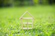 Leinwanddruck Bild - wood house model on grass field