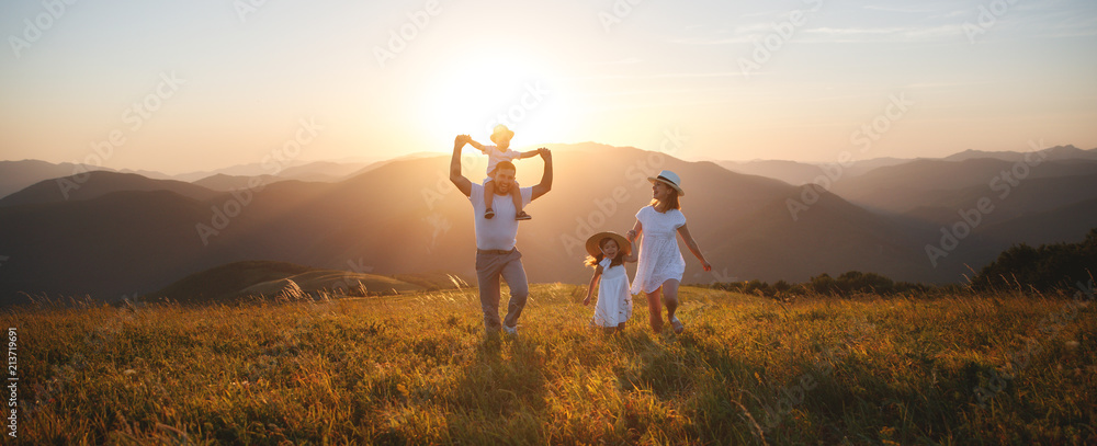 Fototapety, obrazy: Happy family: mother, father, children son and daughter on sunset