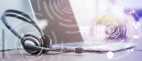 Fototapeta close up soft focus on headset with telephone devices at office desk for custome