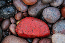 Colorful Wet Stones On Rocky B...