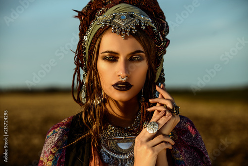 gypsy in rays of sunset