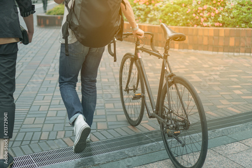 Türaufkleber Fahrrad Man walking with bicycle on path way with sunlight vintage color tone style background