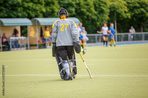 Fotografía  Upset field hockey player goalier after defeat in the game