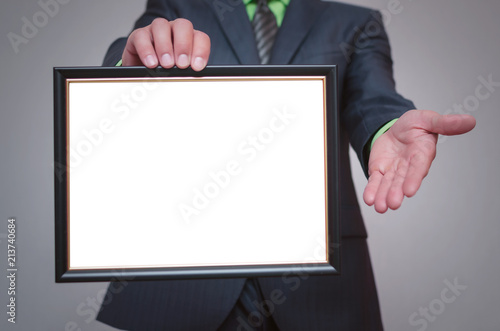 Blank diploma or certificate mock up in businessman hand Canvas Print