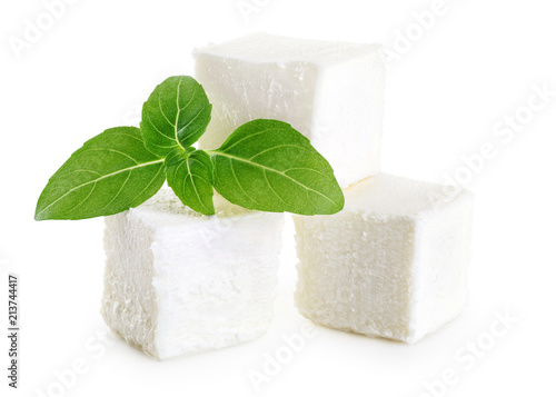 Feta cheese and basil isolated on white background.