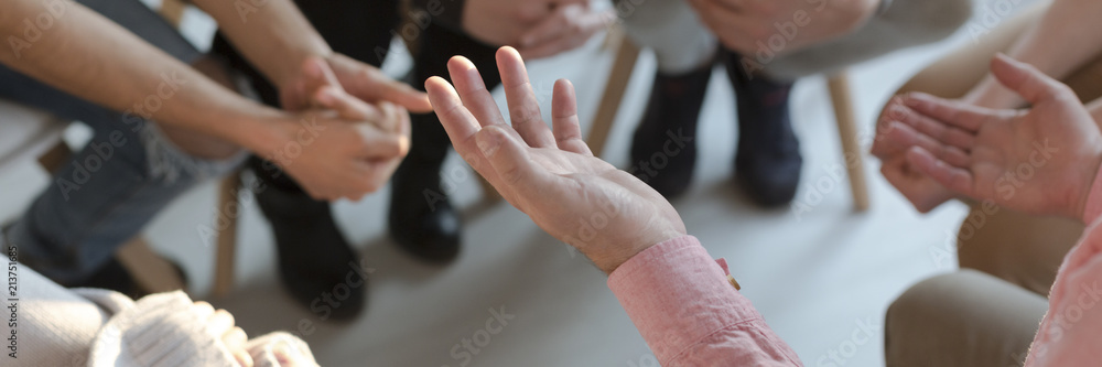Fototapeta Panorama of therapist's hands while gesticulating during group therapy