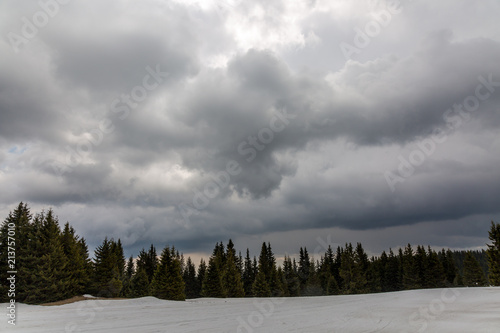 Keuken foto achterwand Donkergrijs Mountain hills with trees and dramatic sky