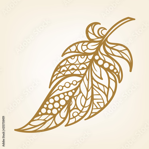 Photo  Patterned decorative feather. Laser cut design in ethnic style.