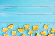 Slices pineapple popsicle sticks with ice on wood plank blue color. summer fruit backgrond concept, top view, copy space