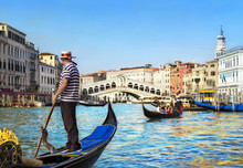 Venice, Italy. Gondolier With Rowing Oar In His Gondola On Grand Canal Look At Rialto Bridge Against Other Gondolas In Sunny Day