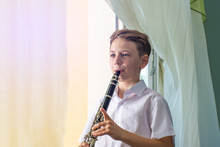 The Boy Learns To Play The Cla...