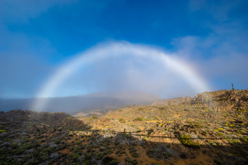 A white rainbow, or a foggy arc after passing a white cloud over the Teide volcano in Tenerife