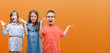 canvas print picture - Group of boy and girls kids over orange background very happy and excited, winner expression celebrating victory screaming with big smile and raised hands