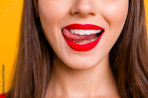Fototapeta Glamour feminine person eat food concept. Half faced photo portrait of sexual naughty charming stunning beautiful pretty lips with matt lipstick ideal contour shape isolated on vivid background obraz