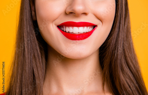 Tablou Canvas Crop close up portrait half face of woman with beaming smile while being at the