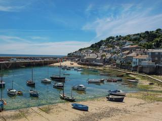Fototapeta na wymiar England, Cornwall, Mousehole Harbour at low tide