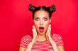 canvas print picture - Say what? Close up portrait of  shocked brunette girl with wide open mouth and big eyes hold palms near face isolated on red vivid background