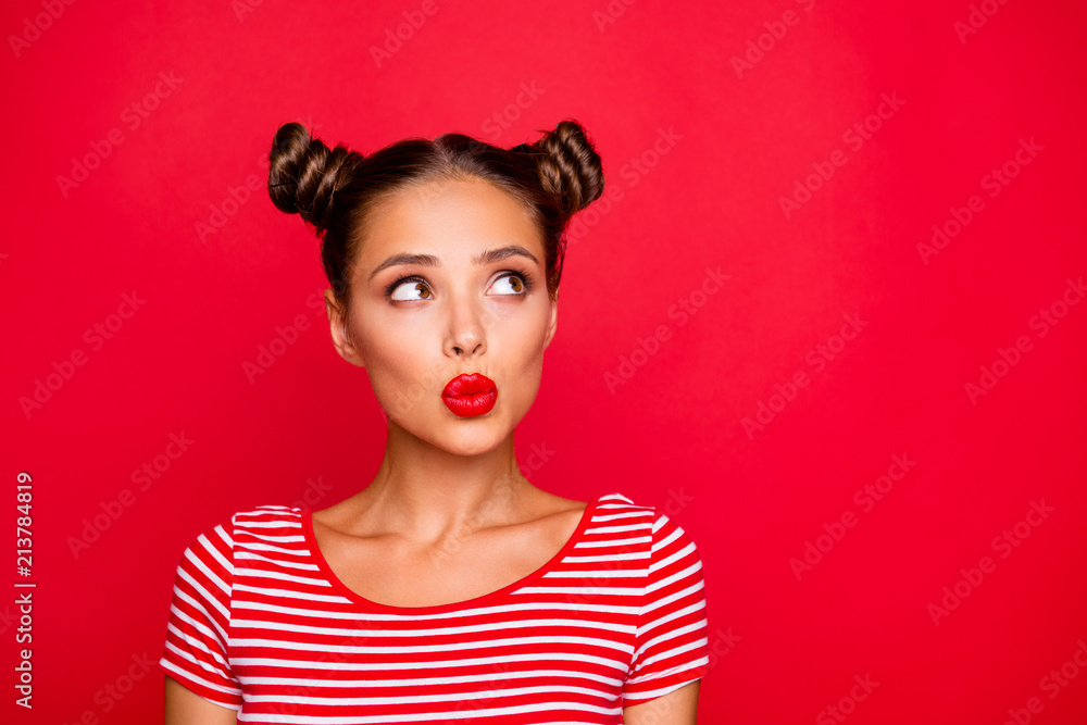 Fototapety, obrazy: Attractive young girl with nice make up wearing striped tshirt puffed up her lips and looked up isolated on bright red background with copy space