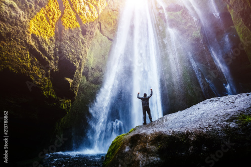 Foto  Perfect view of famous powerful Gljufrabui waterfall in sunlight.