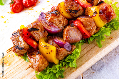 Aluminium Prints Grill / Barbecue tasty and colorful meat skewers with peppers and onions