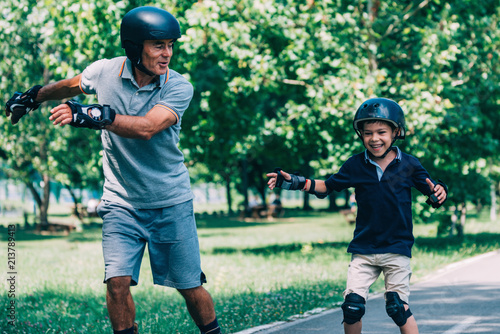 Roller skating race, grandfather and grandson having fun