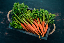 Fresh Carrots In A Wooden Box....