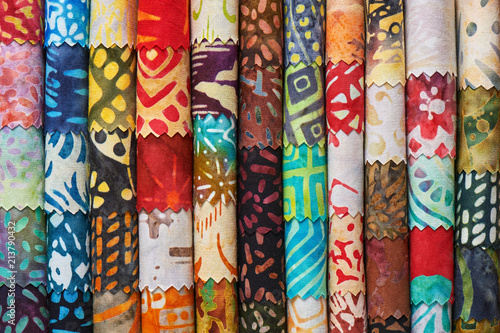 Photo sur Aluminium Tissu Stack of colorful quilting batik fabrics as a vibrant background image