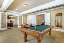 Light Brown Game Room With Bil...