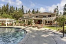 Beautifully Landscaped Backyard With A Large Pool.