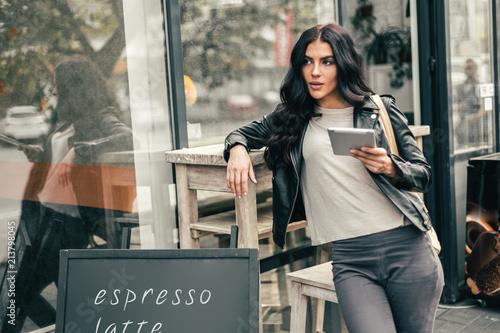 Fotografie, Obraz  Young pretty spanish woman in cafe in city centre