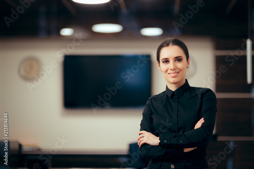 Fotografie, Obraz Receptionist Woman in front of Her Desk Greeting Customers