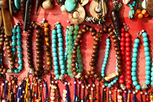 A Lot Of Colorful Bracelets And Beads On A Street Market.