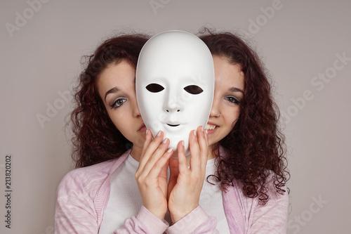 Vászonkép two-faced happy sad woman manic depression or schizophrenia concept
