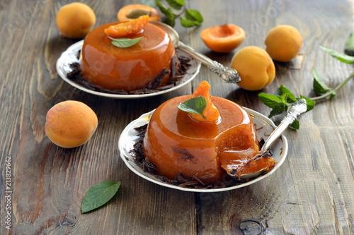 Apricot panna cotta with chocolate shavings and mint Fototapeta
