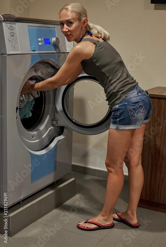 Printed kitchen splashbacks Artist KB girl loads the washing machine in the Laundry