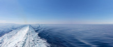 Mediterranean Sea. Boat White Wake, On Blue Sea And Sky Background, View From The Ship. Copy Space, Banner