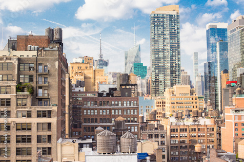 Photo Stands New York New York City Manhattan cityscape of buildings at midtown on sunny day