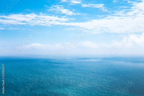 Fotobehang Zee / Oceaan Beautiful seascape in the Atlantic ocean. Beautiful seascape with small waves on the water and amazing clouds in the sky