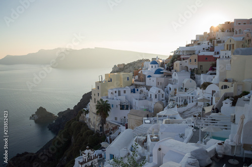 In de dag Santorini Whitewashed Houses and Church on Cliffs with Sea View in Oia, Santorini, Cyclades, Greece