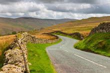 Winding Mountain Road In The Lake District National Park
