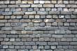 old wall of gray brick