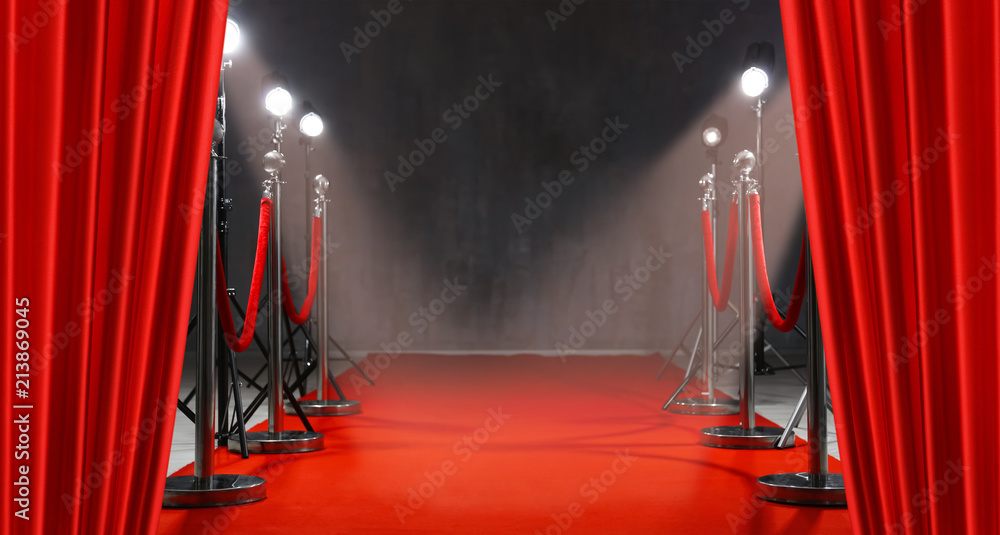 Fototapety, obrazy: Red carpet, rope barriers and spot lights behind curtains indoors