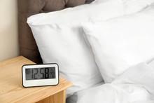 Digital Alarm Clock On Table I...
