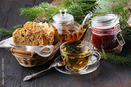 Winter healing orange drink with sea buckthorn, rosemary, spice, fir branches